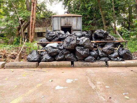 incinerator: Garden incinerator with black bags Stock Photo
