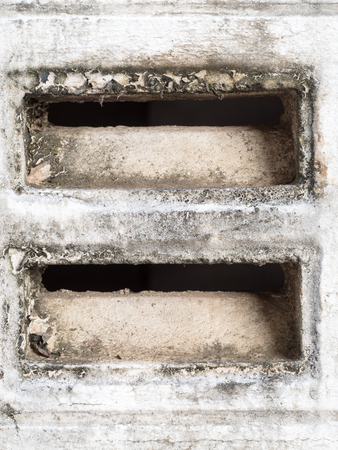 louver: dirty concrete vent on the wall Stock Photo