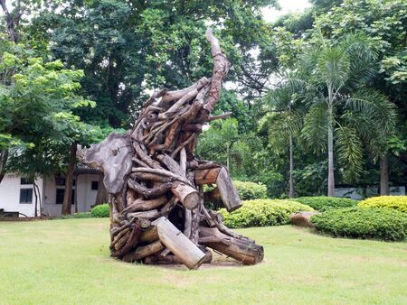 Old wood carving elephant in garden