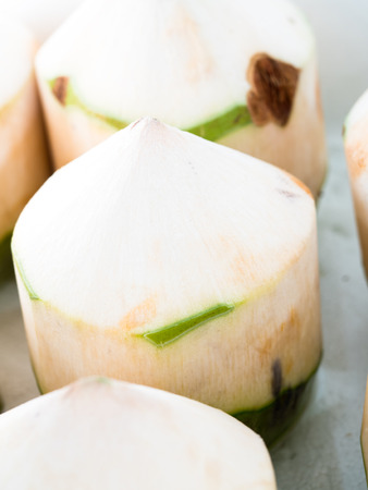 fruit trade: Fresh coconuts in the market,select focus Stock Photo