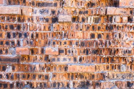 spoilage: Red brick wall with split defective bricks