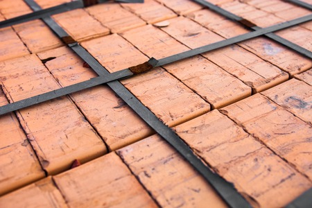 tiedup: Stack of new silicate bricks tied-up with plastic stripe  Close-up