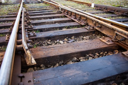 Old railroad track with wooden sleepers and railroad switch photo