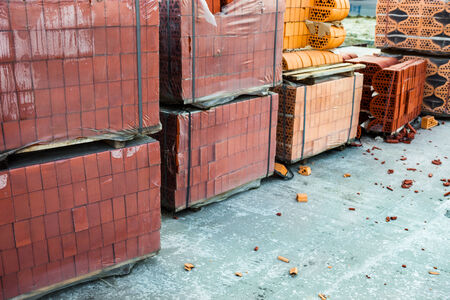 polyethylene: Stacks of silicate bricks on wooden pallets and in polyethylene