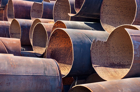 orifice: Lots of rusty metal pipes put together.