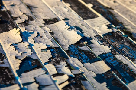 oilpaint: Old wooden planks with the remains of cracked white and blue oil-paint Stock Photo