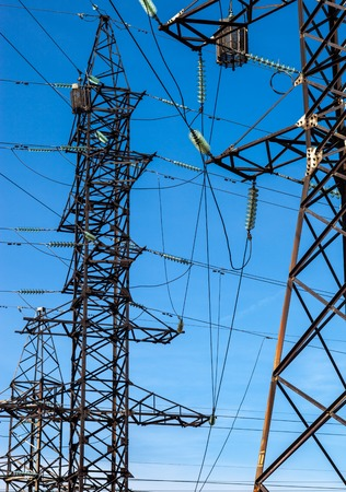 Electricity pylons against the blue sky background. photo