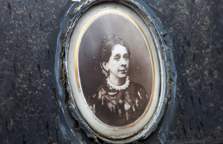 deceased: Portrait of the woman on the gravestone from the middle of the 19th century.