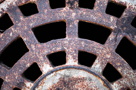 Closeup of the metal manhole cover surface. photo