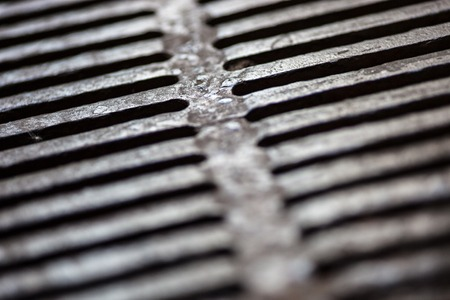 Closeup of the metal drain grate surface photo