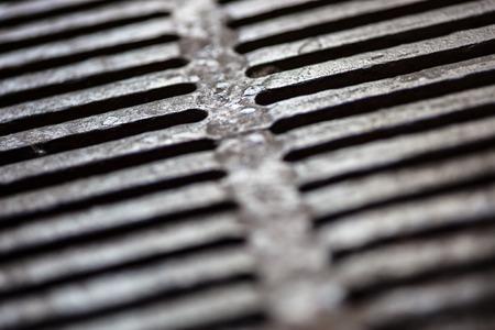 Closeup of the metal drain grate surface photo