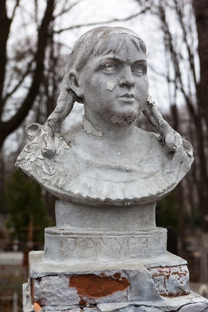 decedent: Old cemetery sculpture of the young girl.