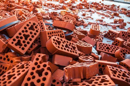 intact: Pile of new intact and beaten silicate bricks Stock Photo
