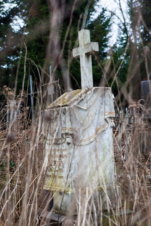 decedent: Old cemetery marble gravestone with the cross Stock Photo