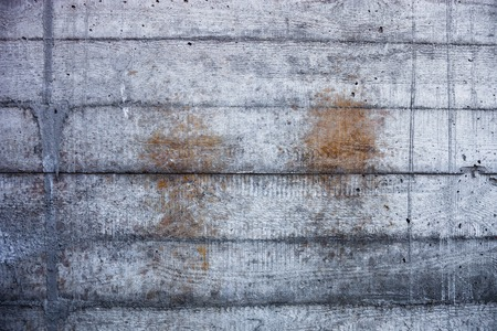 hardened: Grey concrete wall with hardened traces of the shuttering moulds Stock Photo