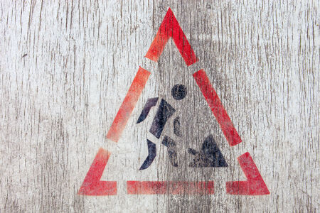 roadworks: Roadworks sign on white painted wooden surface.