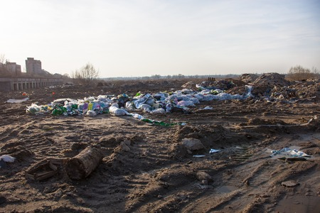 Piles of garbage on the landfill near the city