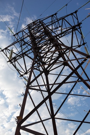 Electricity pylon against the cloudy sky background. photo