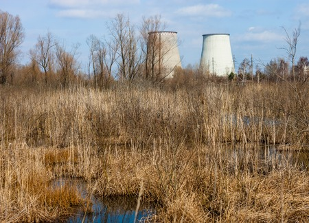 Two cooling towers of the cogeneration plant near Kyiv, Ukraine. Industrial landscape. photo