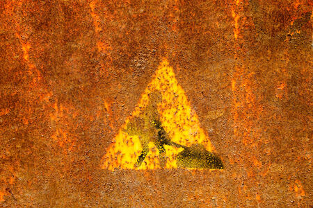 Old roadworks sign on rusty metal surface. photo