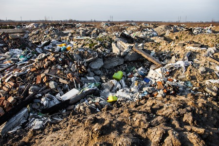 soil pollution: Piles of garbage on the city landfill Stock Photo