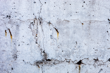 spattered: Grey concrete surface with the hardened traces of the shuttering moulds
