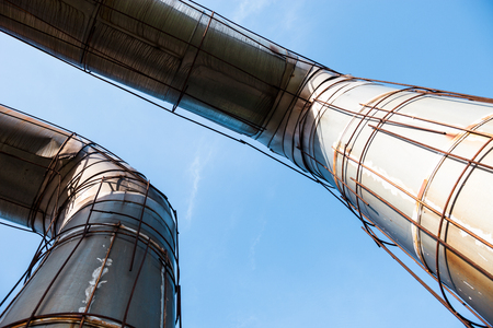 lagging: Elevated section of the pipelines against the blue sky Stock Photo