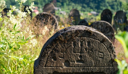 godforsaken: Closeup of the gravestone in the old Jewish cemetery in the Ukrainian Carpathian Mountains. Stock Photo