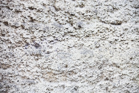 chalky: Whitewashed wall with rich and various texture.