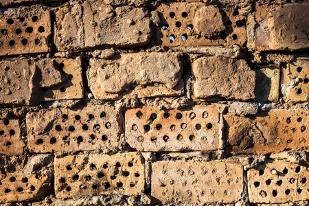 hollow walls: The old brick wall with rich texture.