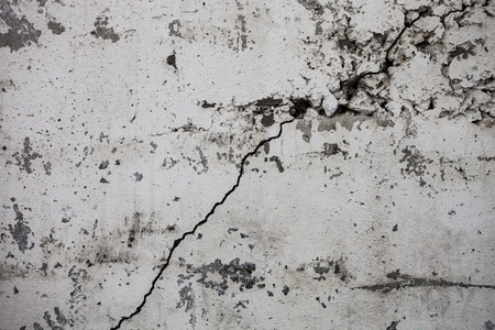 spattered: Cracked whitewashed wall with rich and various texture. Stock Photo