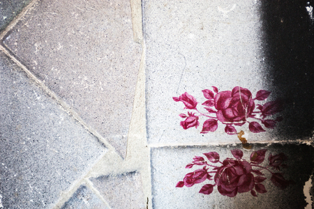 Surface of the old tiles with pink flowers pattern. photo