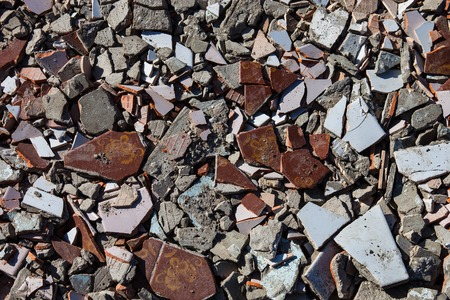spoilage: Pieces of beaten tiles and concrete blocks.