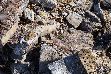Heap of the damaged concrete blocks and bricks. Stock Photo