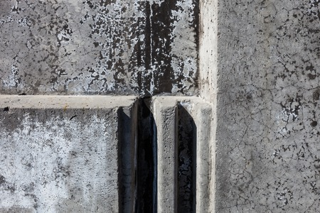 flute structure: Grey concrete blocks surface with rich and various texture.