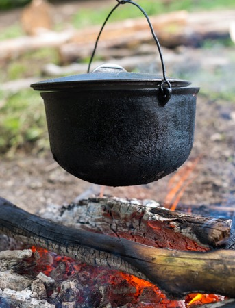 caldron: Cooking in the cauldron on the open fire.