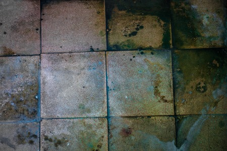 squalor: Surface of the old dirty big square tiles.
