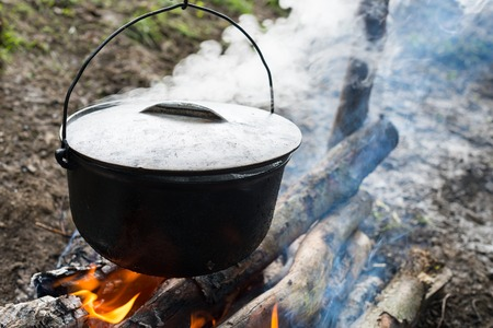 Cooking in the cauldron on the open fire.