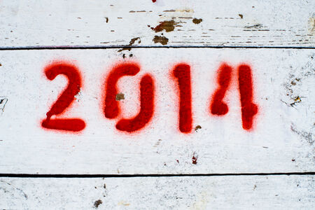 numerate: Red stenciled numbers 2014 on white-painted wooden surface. Stock Photo