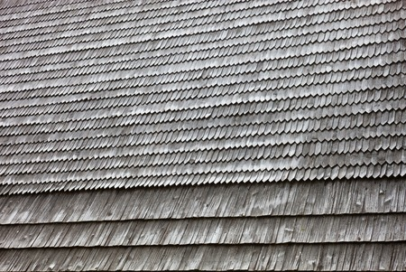 Old wooden shingle roof. Wooden surface texture. photo