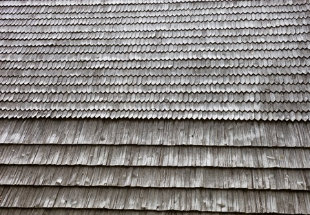 Old wooden shingle roof. Wooden surface texture.
