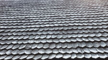 unpainted: Old wooden shingle roof. Wooden surface texture.