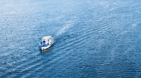 dnieper: The boat floating in the blue Dnieper waters.