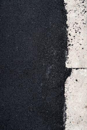 kerb: New asphalt concrete near the concrete kerb.