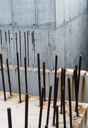 reinforcing: Grey concrete blocks with rusty reinforcing bars