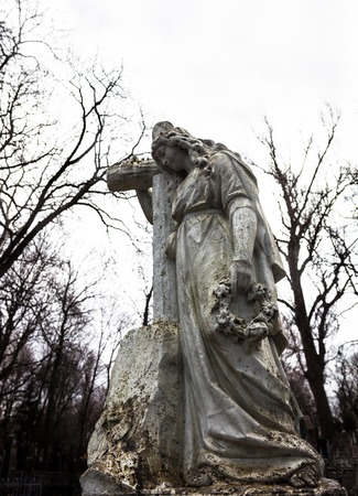 decedent: Old cemetery marble sculpture of the woman with cross