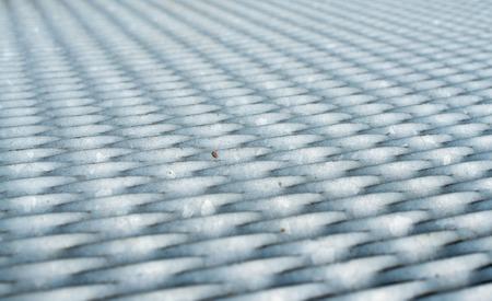 malla metalica: La superficie de malla de metal gris. De cerca.