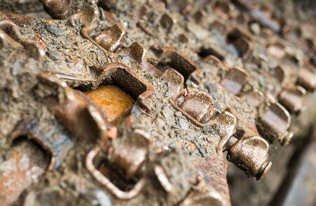 Continuous (caterpillar) tracks of the bulldozer. Close up. photo