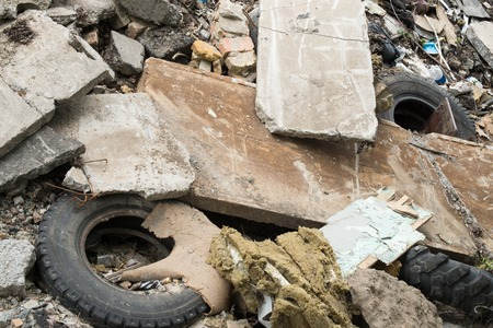 scrapheap: Industrial garbage. Heap of the damaged concrete blocks, old tires and other rubbish Stock Photo