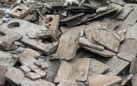 scrapheap: Heap of the damaged concrete blocks. Construction debris.